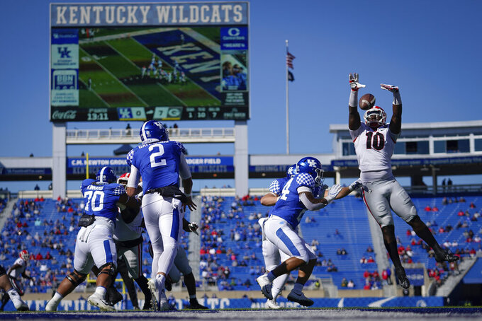 CORRECTS TO GEORGIA DEFENSIVE LINEMAN MALIK HERRING- Georgia defensive lineman Malik Herring (10) blocks the pass of Kentucky quarterback Joey Gatewood (2) during the first half an NCAA college football game, Oct. 31, 2020, in Lexington, Ky. (AP Photo/Bryan Woolston)