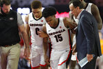 Georgia's Sahvir Wheeler (15) is helped off the court after an injury during the team's NCAA college basketball game against Tennessee on Wednesday, Jan. 15, 2020, in Athens, Ga. (Joshua L. Jones/Athens Banner-Herald via AP)