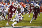 Florida quarterback Anthony Richardson, center, runs past Florida Atlantic defensive lineman Ryan Veingrad (94) and linebacker Antarrius Moultrie (1) on his way to a 73-yard touchdown during the second half of an NCAA college football game Saturday, Sept. 4, 2021, in Gainesville, Fla. (AP Photo/John Raoux)