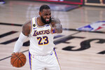 Los Angeles Lakers' LeBron James (23) directs the offense during the second half of an NBA conference semifinal playoff basketball game against the Houston Rockets Saturday, Sept. 12, 2020, in Lake Buena Vista, Fla. (AP Photo/Mark J. Terrill)