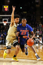Florida guard Scottie Lewis (23) drives against Vanderbilt guard Scotty Pippen Jr. (2) during an NCAA college basketball game Saturday, Feb. 1, 2020, in Nashville, Tenn. (Wade Payne/The Tennessean via AP)