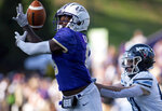 James Madison safety Wayne Davis (8) almost makes an interception on a pass meant for Maine wide receiver Michael Monios, right, during the first half of an NCAA college football game in Harrisonburg, Va., Saturday, Sep. 11, 2021. (Daniel Lin/Daily News-Record Via AP)