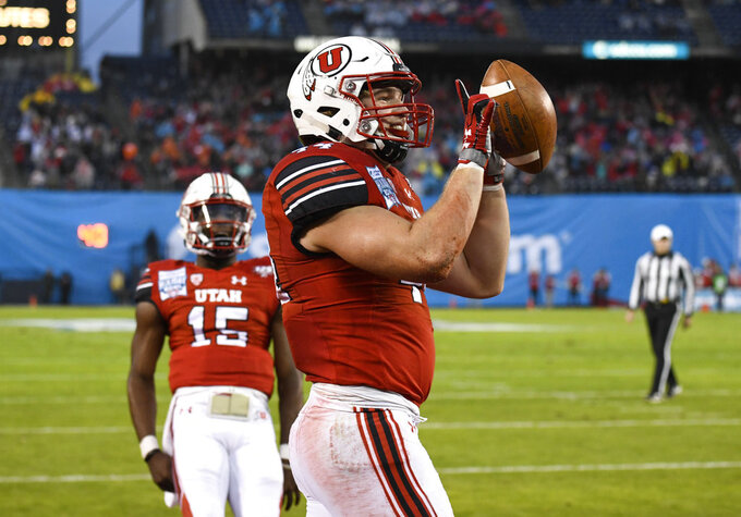 Utah tight end Jake Jackson (44) celebrates after scoring a touchdown during the first half of the Holiday Bowl NCAA college football game against Northwestern, Monday, Dec. 31, 2018, in San Diego. (AP Photo/Denis Poroy)