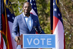 Democratic U.S. Senate challenger the Rev. Raphael Warnock speaks during a rally, Monday, Dec. 21, 2020 in Columbus, Ga. with Vice President-Elect Kamala Harris and fellow Democratic U.S. Senate challenger Jon Ossoff. (AP Photo/Ben Gray)