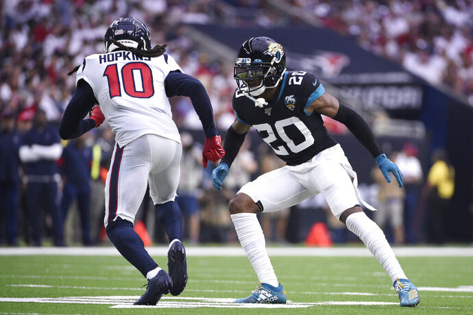 FILE - In this Sunday, Sept. 15, 2019 file photo, Houston Texans wide receiver DeAndre Hopkins (10) runs around Jacksonville Jaguars cornerback Jalen Ramsey (20) during the second half of an NFL football game in Houston. alen Ramsey was thrilled to land with the Los Angeles Rams, and the team is already optimistic about keeping the star cornerback around for a long time. Ramsey headed to the Rams' training complex Wednesday, Oct. 16, 2019 a day after Los Angeles traded two first-round picks to Jacksonville for the mercurial two-time Pro Bowl selection.(AP Photo/Eric Christian Smith, File)