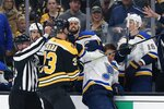 Boston Bruins' Zdeno Chara (33) and St. Louis Blues' Brayden Schenn, center right, scuffle in front of the St. Louis bench during the first period of an NHL hockey game in Boston, Saturday, Oct. 26, 2019. (AP Photo/Michael Dwyer)