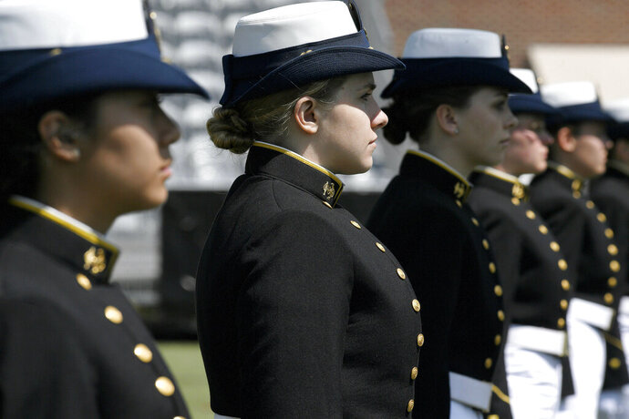 FILE - In this May 22, 2019 file photo, female cadets at the United States Coast Guard Academy line up during commencement in New London, Conn. Released Wednesday, July 3, 2019, a Pentagon report from an anonymous 2018 gender relations survey shows that almost half of female cadets at the U.S. Coast Guard Academy said they experienced sexual harassment and about one in eight women reported experiencing unwanted sexual contact. (AP Photo/Jessica Hill, File)