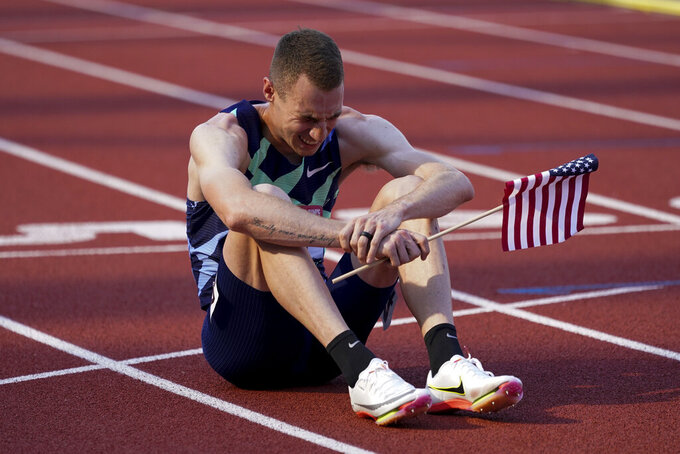 Clayton Murphy celebrates after winning the men's 800-meter run at the U.S. Olympic Track and Field Trials Monday, June 21, 2021, in Eugene, Ore. (AP Photo/Ashley Landis)