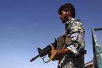 An Afghan policeman stands guard on the outskirts of Mazar-e-Sharif, Afghanistan, Tuesday, Aug. 10, 2021. (AP Photo/Mirwais Bezhan)