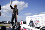 Josef Newgarden celebrates after winning an IndyCar auto race at World Wide Technology Raceway on Sunday, Aug. 30, 2020, in Madison, Ill. (AP Photo/Jeff Roberson)
