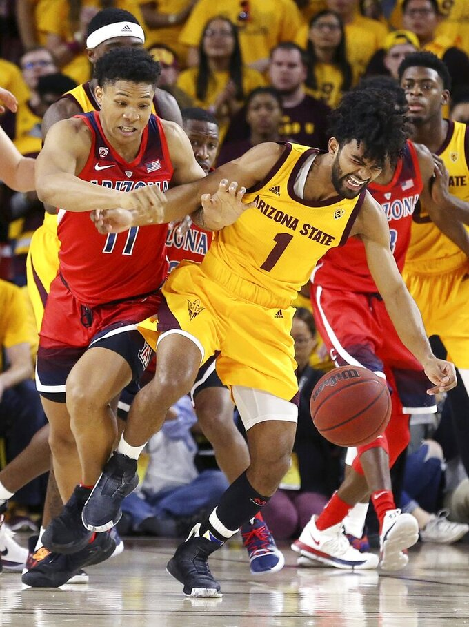 Arizona State guard Remy Martin (1) battles with Arizona forward Ira Lee (11) for the ball during the first half of an NCAA college basketball game Thursday, Jan. 31, 2019, in Tempe, Ariz. (AP Photo/Ross D. Franklin)