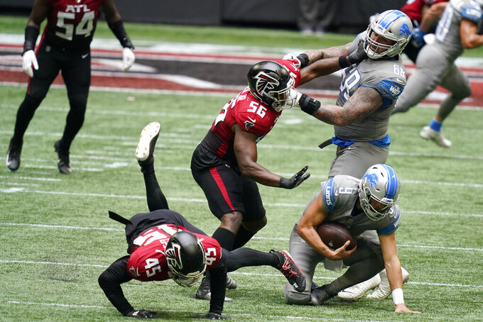 Atlanta Falcons defensive end Dante Fowler Jr. (56) collides with Detroit Lions offensive tackle Taylor Decker (68) during a sack of Detroit Lions quarterback Matthew Stafford (9) during the second half of an NFL football game, Sunday, Oct. 25, 2020, in Atlanta. (AP Photo/Brynn Anderson)