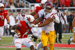 Southern California defensive lineman Christian Rector (89) tackles Utah running back Zack Moss (2) during the first half of an NCAA college football game Saturday, Oct. 20, 2018, in Salt Lake City. (AP Photo/Rick Bowmer)
