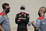 Race driver driver Will Power, middle, of Australia, talks with his crew after winning the pole for the IndyCar auto race at Indianapolis Motor Speedway in Indianapolis, Friday, July 3, 2020. (AP Photo/Darron Cummings)