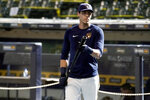 FILE - In this Monday, July 6, 2020, file photo, Milwaukee Brewers' Christian Yelich waits to hit during baseball practice at Miller Park in Milwaukee. (AP Photo/Morry Gash, File)