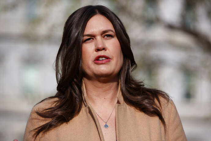 FILE - In this April 4, 2019, file photo, White House press secretary Sarah Sanders talks with reporters outside the White House in Washington. (AP Photo/Evan Vucci, File)