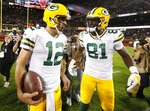 Green Bay Packers' Aaron Rodgers celebrates with Geronimo Allison (81) after an NFL football game against the Chicago Bears Thursday, Sept. 5, 2019, in Chicago. The Packers won 10-3. (AP Photo/Morry Gash)