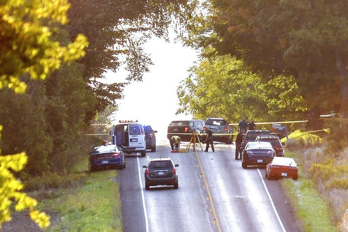 Police work the scene of a crash involving an Amish buggy on Wednesday, Sept. 18, 2019, in Chester Township in Eaton County. Eaton County Undersheriff Jeff Cook says the buggy was struck from behind Wednesday as it traveled along Vermontville Highway near Charlotte in southern Michigan. (Nick King/Lansing State Journal via AP)