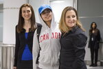 Rahaf Mohammed Alqunun, 18, center, stands with Canadian Minister of Foreign Affairs Chrystia Freeland, right, as she arrives at Toronto Pearson International Airport, on Saturday, Jan.12, 2019.  The Saudi teen fled her family while visiting Kuwait and flew to Bangkok, where she barricaded herself in an airport hotel and launched a Twitter campaign that drew global attention to her case. Prime Minister Justin Trudeau announced his government would accept her as a refugee.  (Chris Young/The Canadian Press via AP)