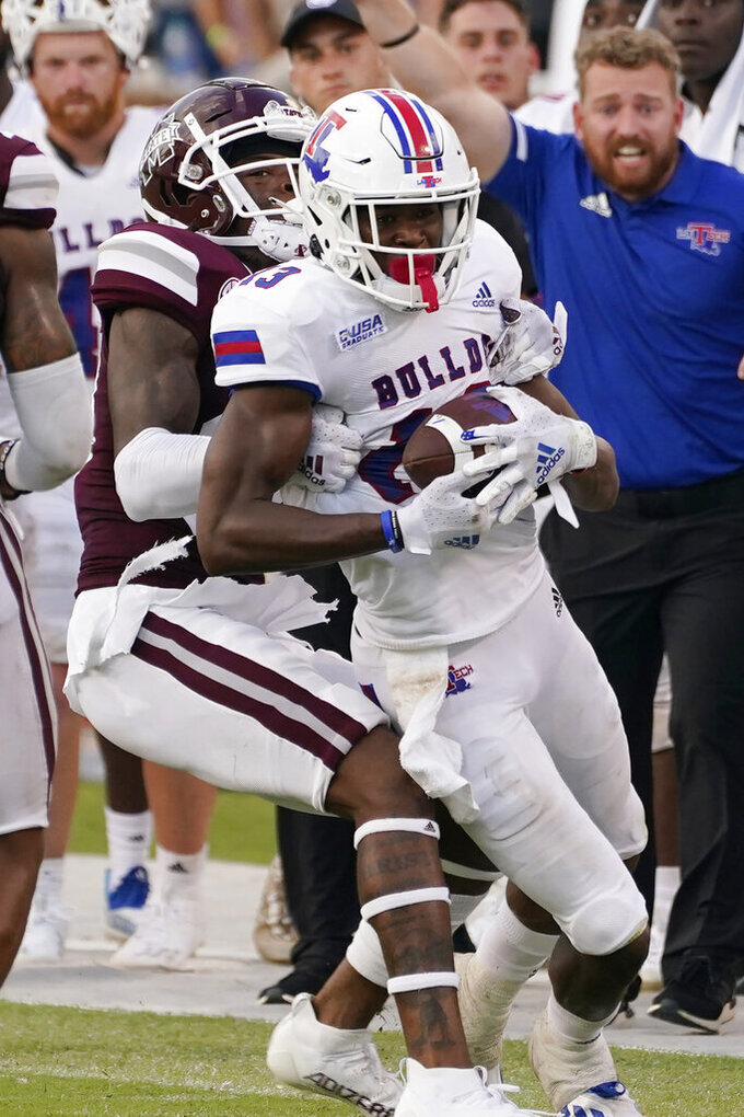 Louisiana Tech wide receiver Isaiah Graham (13) is tackled from behind by a Mississippi State player after catching a pass during the second half of an NCAA college football game in Starkville, Miss., Saturday, Sept. 4, 2021. Graham was injured on the play and had to be carted off the field. Mississippi State won 35-34. (AP Photo/Rogelio V. Solis)