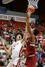 Washington State forward CJ Elleby, left, shoots while defended by Stanford forward Oscar da Silva during the second half of an NCAA college basketball game in Pullman, Wash., Saturday, Jan. 19, 2019. Stanford won 78-66. (AP Photo/Young Kwak)