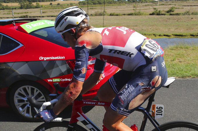 Latvia's Toms Skujins rides after falling during the tenth stage of the Tour de France cycling race over 168.5 kilometers (104.7 miles) from Ile d'Oleron to Ile de Re, France, Tuesday, Sept. 8, 2020. (AP Photo/Thibault Camus)
