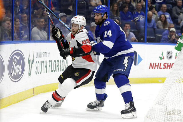 Tampa Bay Lightning left wing Pat Maroon (14) rides Ottawa Senators defenseman Cody Goloubef (29) into the boards during the second period of an NHL hockey game Tuesday, Dec. 17, 2019, in Tampa, Fla. (AP Photo/Chris O'Meara)