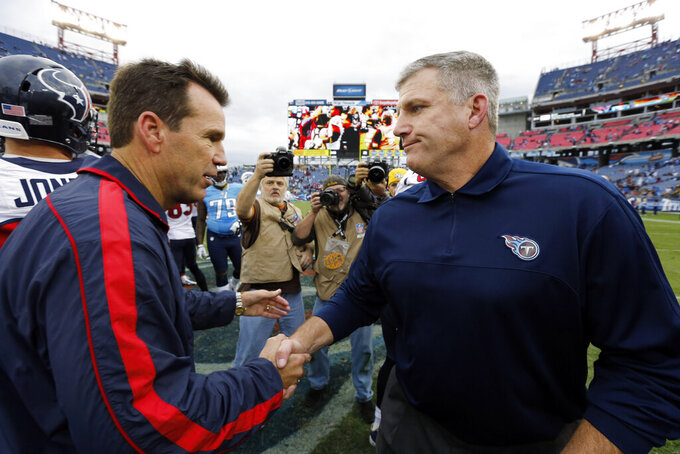 FILE - In this Dec. 2, 2012 file photo Tennessee Titans head coach Mike Munchak, right, congratulates Houston Texans head coach Gary Kubiak after an NFL football game in Nashville, Tenn. Munchak, who had been a finalist for the Denver Broncos head coaching job, is making a lateral move from the Pittsburgh Steelers to serve as the Broncos' new offensive line coach, a person with knowledge of the agreement told The Associated Press on Monday, Jan. 14, 2019. The person also said the Broncos are allowing Gary Kubiak to interview elsewhere and have received permission to interview 49ers QBs coach Rich Scangarello for their offensive coordinator opening. (AP Photo/Joe Howell)
