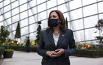 U.S. Vice President Kamala Harris takes questions from media as she visits the Flower Dome at Gardens by the Bay, following her foreign policy speech, in Singapore Tuesday, Aug. 24, 2021. (Evelyn Hockstein/Pool Photo via AP)