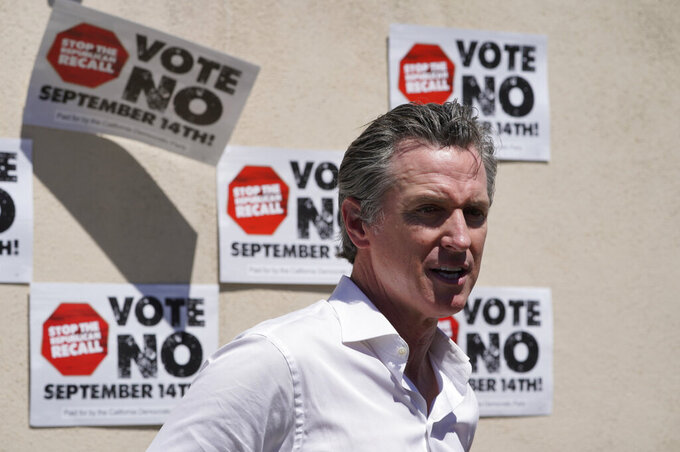 California Gov. Gavin Newsom takes questions from the media after a campaign event against the California recall election at Culver City High School in Culver City, Calif., Saturday, Sept. 4, 2021. (AP Photo/Damian Dovarganes)