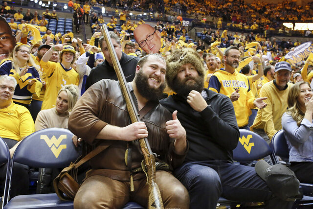 Pittsburgh Steelers quarterback Ben Roethlisberger, right, poses with the West Virginia Mountaineer Mascot before West Virginia's NCAA college basketball game against Kansas on Wednesday, Feb. 12, 2020, in Morgantown, W.Va. (AP Photo/Kathleen Batten)