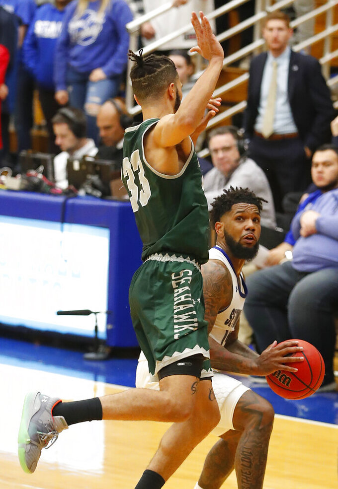 Wagner guard Curtis Cobb III (33) defends against Seton Hall guard Myles Powell (13) during the second half of an NCAA college basketball game Tuesday, Nov. 5, 2019, in South Orange, N.J. (AP Photo/Noah K. Murray)