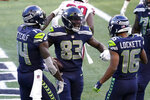 Seattle Seahawks wide receiver David Moore (83) celebrates with DK Metcalf, left, and Tyler Lockett (16), after Moore scored a touchdown against the San Francisco 49ers during the second half of an NFL football game, Sunday, Nov. 1, 2020, in Seattle. (AP Photo/Elaine Thompson)