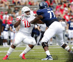 Houston defensive tackle Ed Oliver (10) works around Rice offensive lineman Uzoma Osuji (77) in the first half of a NCAA college football game Saturday, Sep. 1, 2018, in Houston. (AP Photo/Michael Wyke)