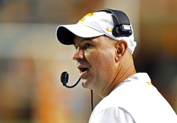 Tennessee head coach Jeremy Pruitt yells to his players in the second half of an NCAA college football game against Missouri Saturday, Nov. 17, 2018, in Knoxville, Tenn. (AP Photo/Wade Payne)
