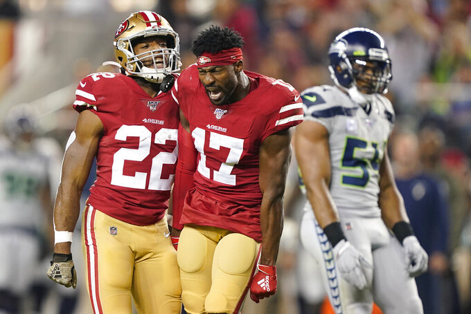 San Francisco 49ers wide receiver Emmanuel Sanders (17) yells next to running back Matt Breida (22) and Seattle Seahawks middle linebacker Bobby Wagner (54) during the first half of an NFL football game in Santa Clara, Calif., Monday, Nov. 11, 2019. (AP Photo/Tony Avelar)