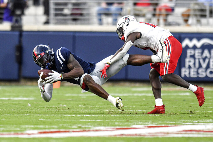 Mississippi wide receiver Jonathan Mingo, left, catches a pass against Austin Peay defensive back Kordell Jackson (13) during an NCAA college football game in Oxford, Miss., Saturday, Sept. 11, 2021. (AP Photo/Bruce Newman)