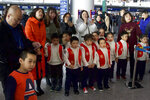 A group of children in costume wait to perform at Beijing Capital International Airport in Beijing, Friday, Jan. 17, 2020. China's population crept past 1.4 billion in 2019 for the first time, even as the birthrate continues to fall. (AP Photo/Ng Han Guan)