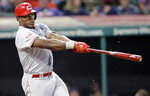 Cincinnati Reds' Yasiel Puig hits a double off Cleveland Indians starting pitcher Trevor Bauer in the seventh inning in a baseball game, Tuesday, June 11, 2019, in Cleveland. (AP Photo/Tony Dejak)