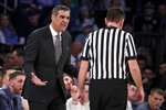 Villanova head coach Jay Wright, left, talks to referee Pat Driscoll during the first half of an NCAA college basketball game against Seton Hall in the championship of the Big East Conference tournament, Saturday, March 16, 2019, in New York.  Villanova won 74-72. (AP Photo/Julio Cortez)
