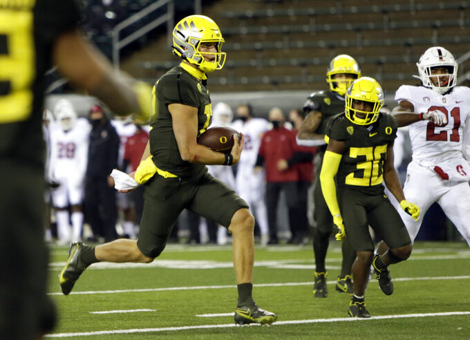 Oregon's Tyler Shough scores a touchdown during the third quarter of an NCAA college football game Saturday, Nov. 7, 2020, in Eugene, Ore. (AP Photo/Chris Pietsch)