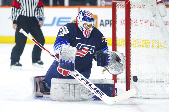 United States' Alex Cavallini knocks away the puck during the first period of the team's hockey game against the Canada, Friday, Oct. 22, 2021, in Allentown, Pa. (AP Photo/Chris Szagola)
