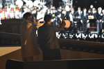 Japan's Emperor Naruhito and Empress Masako wave lanterns to well-wishers during a national celebration to mark his enthronement at the entrance of the Imperial Palace in Tokyo Saturday, Nov. 9, 2019. Naruhito has thanked tens of thousands of well-wishers who gathered outside the palace to congratulate his enthronement at the ceremony organized by conservative political and business groups. (Kazuhiro Nogi/Pool Photo via AP)