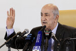 Newly elected Algerian President Abdelmadjid Tebboune gestures during a press conference Friday, Dec.13, 2019 in Algiers. Abdelmadjid Tebboune, a former prime minister and loyalist of the influential army chief, was declared the oil-rich nation's new president in an election boycotted by members of the vibrant pro-democracy movement. (AP Photo/Fateh Guidoum,)