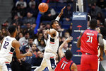 Connecticut's Isaiah Whaley, center left, blocks a shot by New Jersey Institute of Technology's Shyquan Gibbs (11) in the second half of an NCAA college basketball game Sunday, Dec. 29, 2019, in Hartford, Conn. (AP Photo/Stephen Dunn)