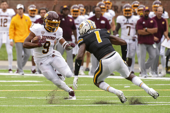 Central Michigan running back Marion Lukes, left, tries to run past Missouri's Jaylon Carlies, right, during the third quarter of an NCAA college football game Saturday, Sept. 4, 2021, in Columbia, Mo. (AP Photo/L.G. Patterson)