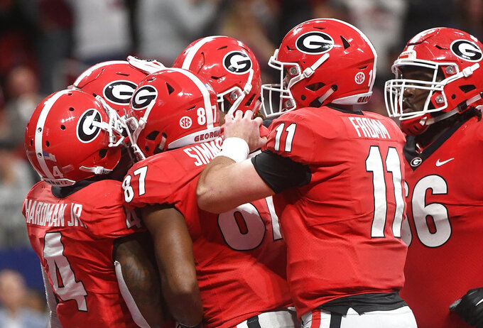 Georgia offense huddles in the end zone after a Georgia tight end Isaac Nauta touchdown against Alabama during the first half of the Southeastern Conference championship NCAA college football game, Saturday, Dec. 1, 2018, in Atlanta. (AP Photo/John Amis)
