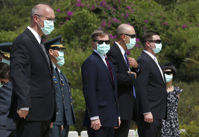 The officials of American Institute in Taiwan (AIT) attend a ceremony commemorating the 62nd anniversary of deadly attack by China on Kinmen island,  in Kinmen, Taiwan, Sunday, Aug. 23, 2020. (AP Photo/Chiang Ying-ying)