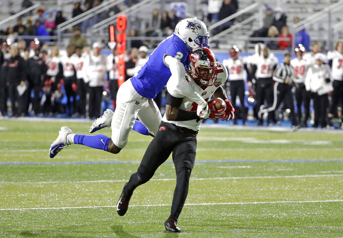 Western Kentucky wide receiver Lucky Jackson (11) catches a 46-yard touchdown pass as he is defended by Middle Tennessee's Chris Stamps (2) during the second half of an NCAA college football game Friday, Nov. 2, 2018, in Murfreesboro, Tenn. Middle Tennessee won 29-10. (AP Photo/Mark Humphrey)