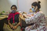 A woman receives Covishield COVID-19 vaccine at a vaccination center in Mumbai, India, Thursday, Sept. 23, 2021. (AP Photo/Rafiq Maqbool)